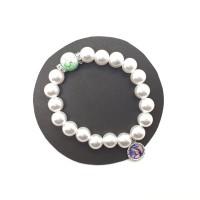 Bracelet blanc, perle verte et strass